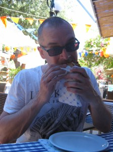 Matt with a pork gyros at a taverna on Nafklirou, Kos Town